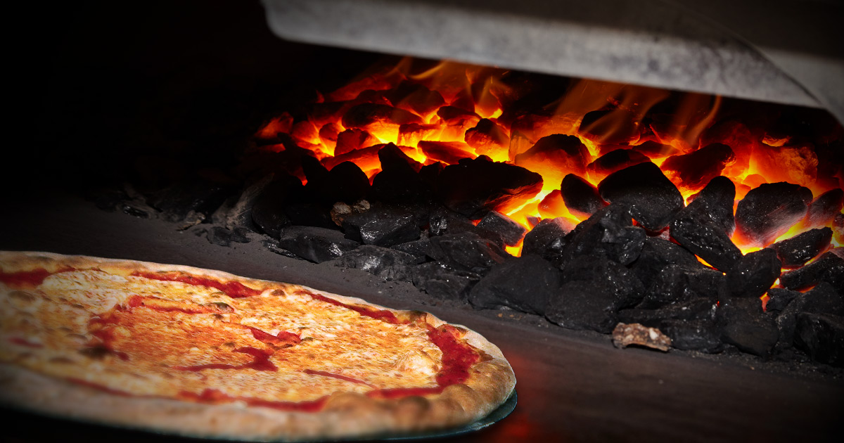 pizza on a charcoal
